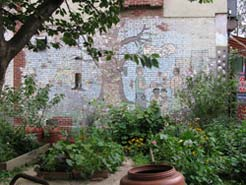 garden with a mural on a brick wall